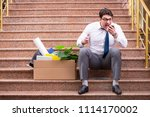young businessman on the street ... | Shutterstock . vector #1114170002