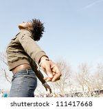 Small photo of Attractive black woman expressing freedom against an intense blue sky, bending backwards with her arms stretched.
