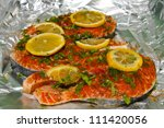 raw pink salmon with herbs and...