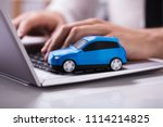 close up of a small blue car on ... | Shutterstock . vector #1114214825