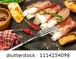thinly sliced german black... | Shutterstock . vector #1114254098