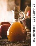 apple vinegar. bottle of apple...   Shutterstock . vector #1114284428
