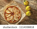 delicious pear tart on table   Shutterstock . vector #1114338818