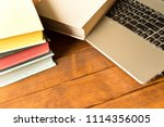 books and laptop on wooden... | Shutterstock . vector #1114356005
