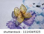 embroidery on white canvas ...   Shutterstock . vector #1114369325