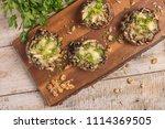mushroom caps stuffed with...   Shutterstock . vector #1114369505
