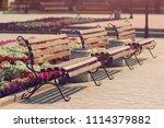 empty retro vintage benches in... | Shutterstock . vector #1114379882