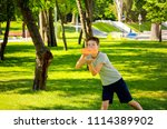 boy playing frisbee in the park | Shutterstock . vector #1114389902