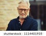 smiling senior man with a beard ... | Shutterstock . vector #1114401935