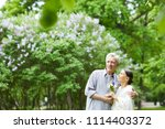 affectionate seniors enjoying... | Shutterstock . vector #1114403372