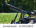 the machine gun is fixed on the ...   Shutterstock . vector #1114413695