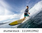 surfer riding on big waves on... | Shutterstock . vector #1114413962