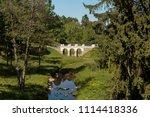 stone bridge and trees in ... | Shutterstock . vector #1114418336