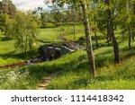 stone bridge and trees in ... | Shutterstock . vector #1114418342