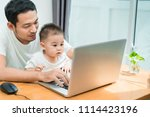asian father and little son... | Shutterstock . vector #1114423196