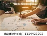 business analyzing charts and... | Shutterstock . vector #1114423202