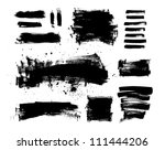 A collection of black grungy vector abstract hand-painted brush strokes - stock vector