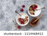 two bowls with yogurt  honey ... | Shutterstock . vector #1114468412