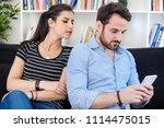 jealous woman spying boyfriend... | Shutterstock . vector #1114475015