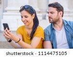 suspicious boyfriend spying his ... | Shutterstock . vector #1114475105