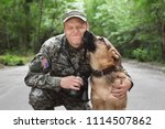 Man In Military Uniform With...