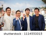 Small photo of CANNES, FRANCE - MAY 11, 2018: Actor Ji-Hoon Ju, actor Sung-min Lee, director Jong-bin Yoon and actor Jung-min Hwang attend the 'The Spy Gone North (Gongjak)' Photocall on 71 Cannes Film Festival
