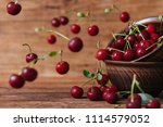 sweet cherry on wooden... | Shutterstock . vector #1114579052