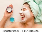 woman laying on the beautician... | Shutterstock . vector #1114606028