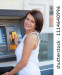 woman withdrawing money from... | Shutterstock . vector #1114640996