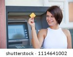 woman withdrawing money from... | Shutterstock . vector #1114641002