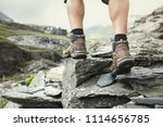 hiker hiking over rocks on a... | Shutterstock . vector #1114656785