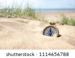 golden compass buried in the... | Shutterstock . vector #1114656788
