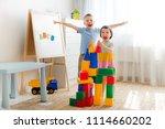 happy preschool children play... | Shutterstock . vector #1114660202