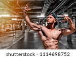 extremely fit guy posing and... | Shutterstock . vector #1114698752