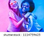 happy women friends making... | Shutterstock . vector #1114759625