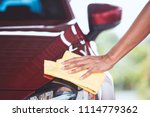 man washing and cleaning red... | Shutterstock . vector #1114779362