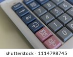 equal markers on the calculator. | Shutterstock . vector #1114798745
