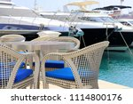table with chairs on terrace... | Shutterstock . vector #1114800176