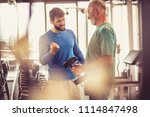 senior man at gym taking weight ... | Shutterstock . vector #1114847498