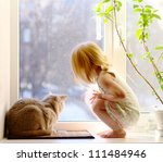 cat and girl looking out of the ... | Shutterstock . vector #111484946