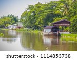 attractive boat house on the... | Shutterstock . vector #1114853738