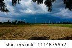 wind farm plant with dark black ... | Shutterstock . vector #1114879952