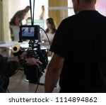 behind the scenes of the camera ... | Shutterstock . vector #1114894862