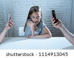 mother and father using mobile... | Shutterstock . vector #1114913045