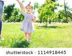 adorable baby girl holding...   Shutterstock . vector #1114918445