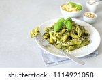 pesto pasta. pasta penne in a... | Shutterstock . vector #1114921058