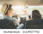 young modern couple driving... | Shutterstock . vector #1114927742