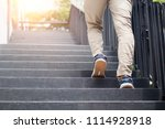 young man walking up the stairs ... | Shutterstock . vector #1114928918