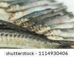 fresh fish on ice in a fish... | Shutterstock . vector #1114930406