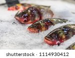 fresh fish on ice in a fish... | Shutterstock . vector #1114930412